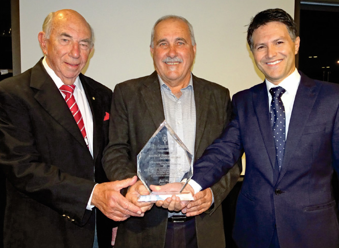 Photo of Maurie Dawson receiving his Ryde Sports Foundatioin Contributioin to Sport Award from Jim Hull & Ryde MP Victor Dominello