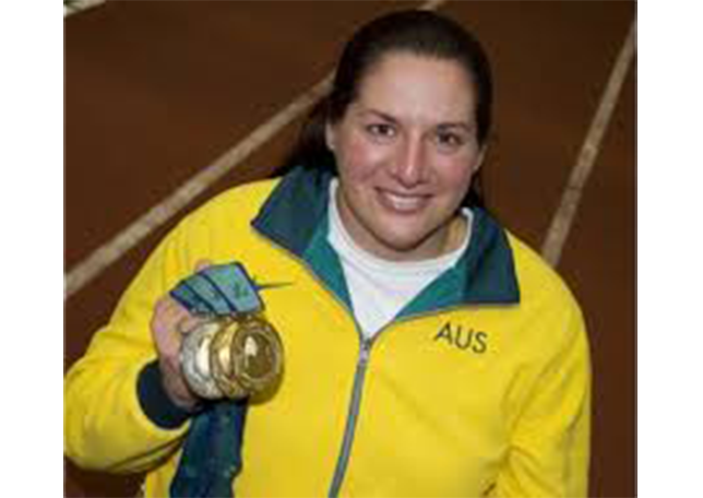 Photo of Louise Sauvage holding gold medals